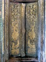 Vat Long Khoun large details, gold-stencilled wooden entry doors, with devas or figures from Jataka stories and canids