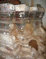 Vat Chom Phet interior details, lower altar stand, showing  poorly repaired extensive damage